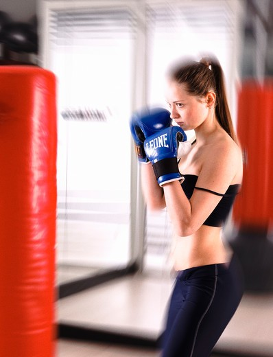 Stock Photo: 4292-3806 Woman doing fit-box in gym