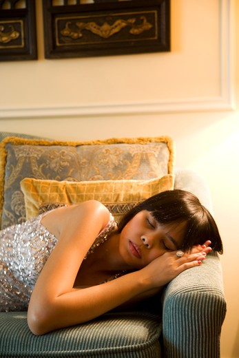 Woman sleeping on sofa : Stock Photo