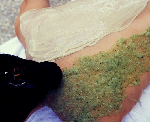 Volcanic clay body scrub for cellulite and cucumber wrap for sunburn : Stock Photo