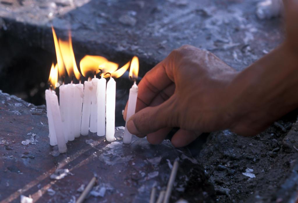 Burma, hand and candles : Stock Photo