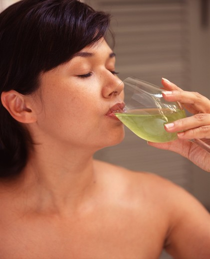 Stock Photo: 4292-41593 Asian woman drinking