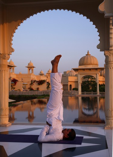 India, Udaipur, Rajastan,Uberoi Udai Vilas Hotel, man doing yoga : Stock Photo