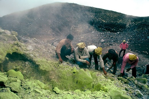 Stock Photo: 4292-43198 Collecting ulphur from  the summit of Ternate volcano. Ternate, Moluccas, Indonesia