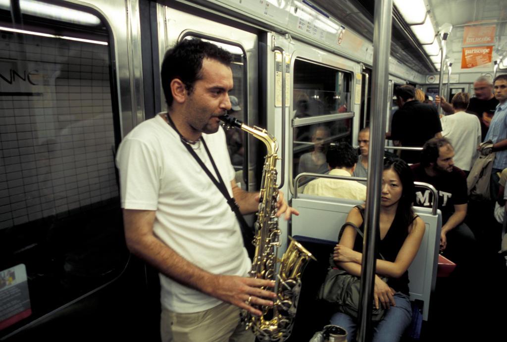 Stock Photo: 4292-48000 Man playing saxophone in metro, Paris, France