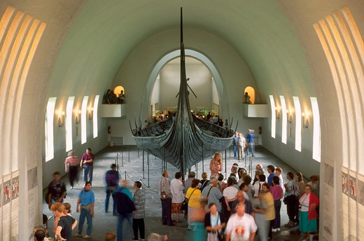 Norway, Oslo, the Viking museum, visitors looking ship : Stock Photo