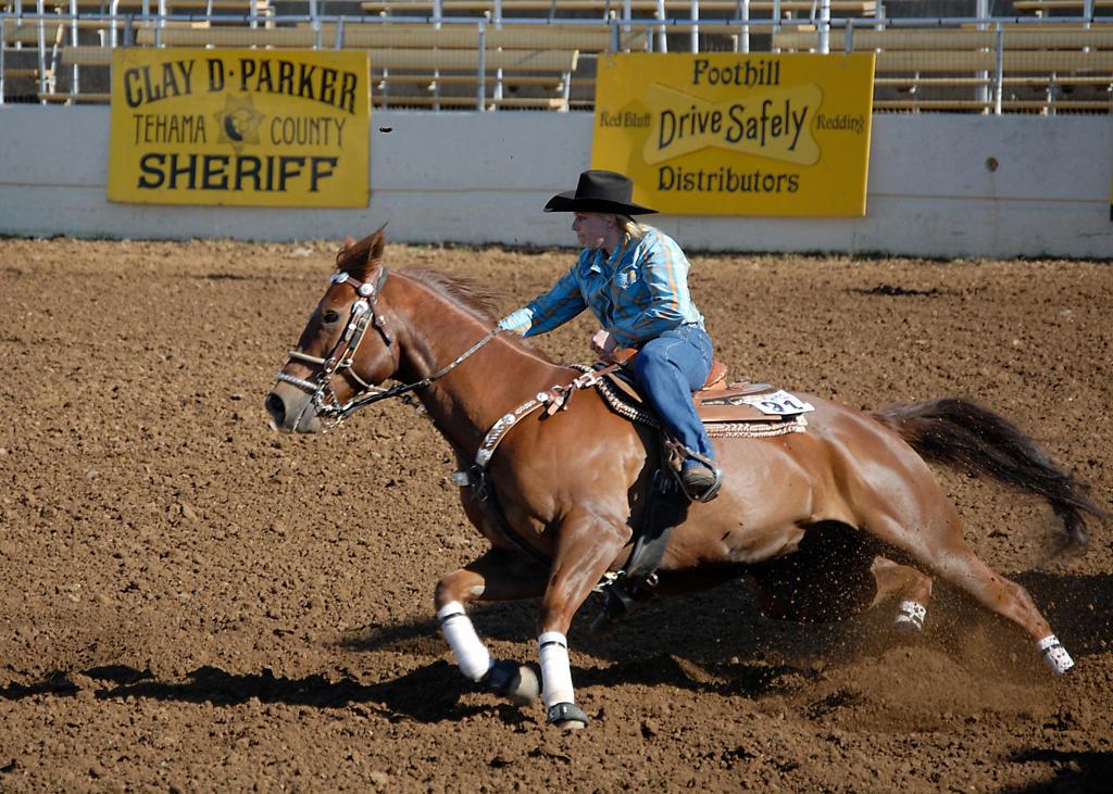 Stock Photo: 4292-48266 USA, Redding, California, cowgirl, Barrel Racing at