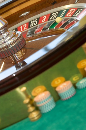 Gambling at roulette table : Stock Photo