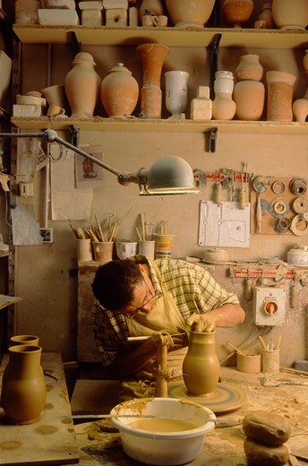 Stock Photo: 4292-52565 France, Provence, clay worker, making pot