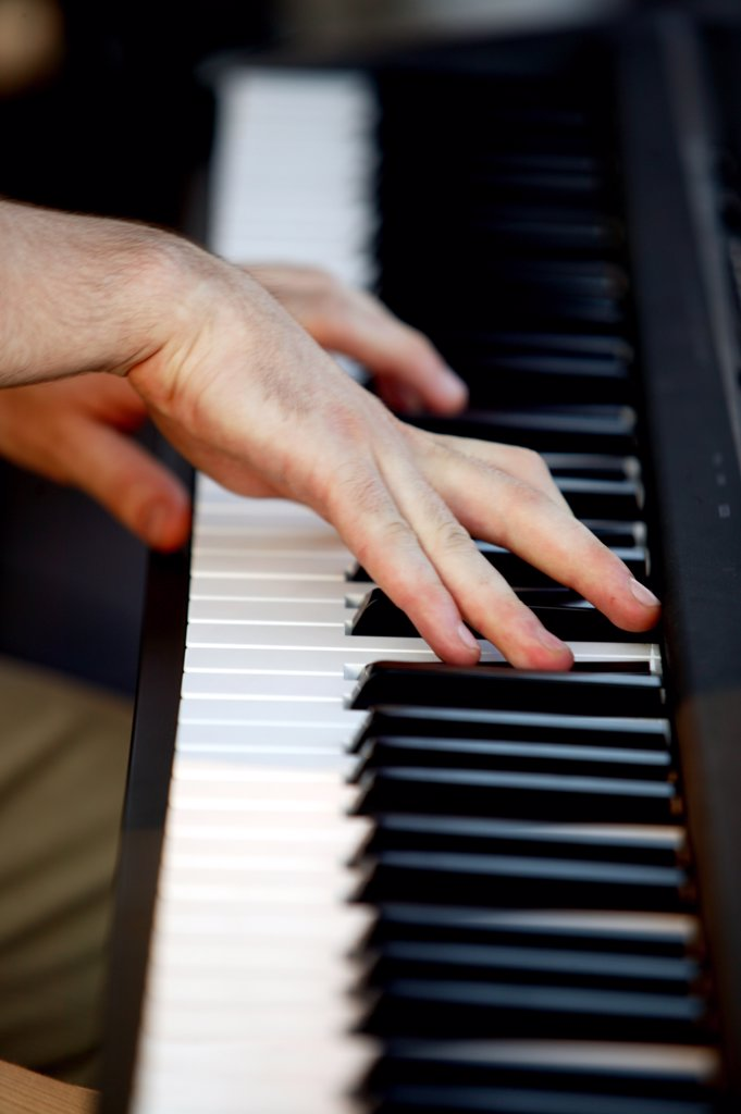 Hands playing piano : Stock Photo