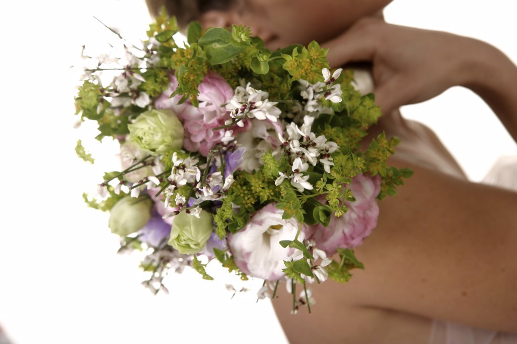 Stock Photo: 4292-59849 Young bride holding a bouquet of flowers
