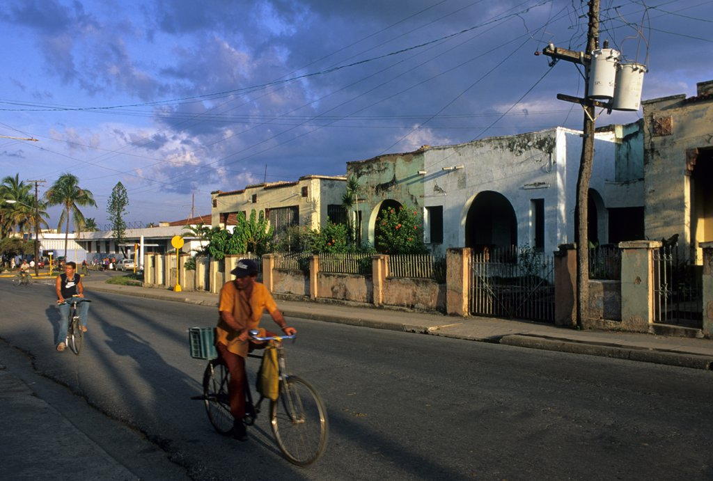 Cuba, Santa Clara, people on bicycle : Stock Photo