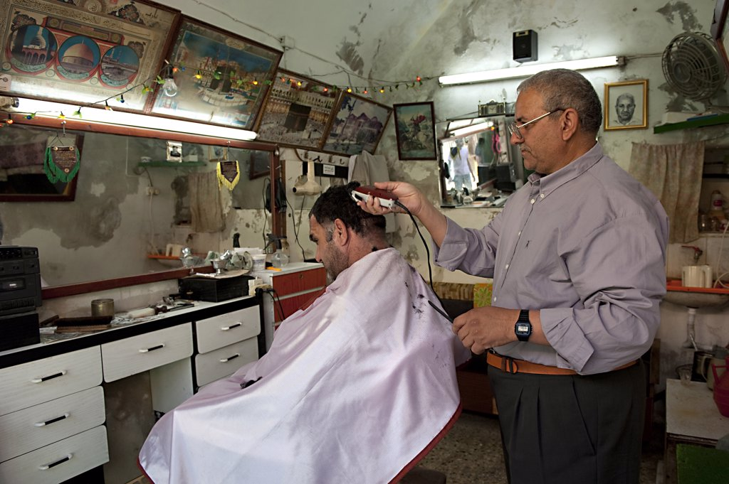 Israel, West Bank, Hebron, barber shop : Stock Photo