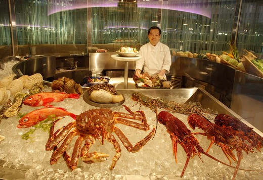 Chef with fresh seafood : Stock Photo