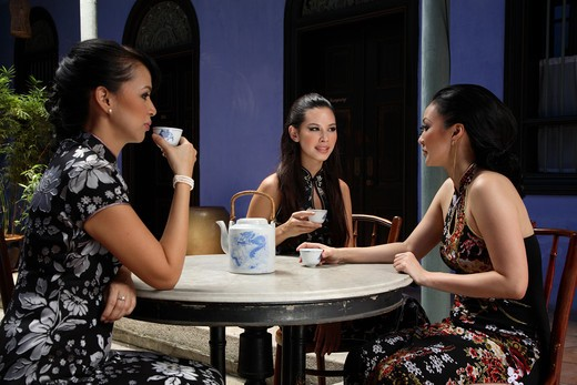Women having Chinese tea at Cheong Fatt Tze Mansion in Penang, Malaysia : Stock Photo