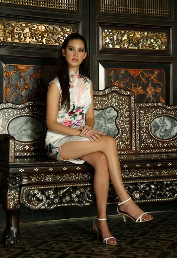 Stock Photo: 4292-6591 Woman wearing cheongsam at Cheong Fat Ze Mansion in Penang, Malaysia