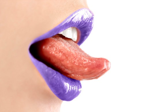 Close up of woman's mouth wearing purple lipstick : Stock Photo