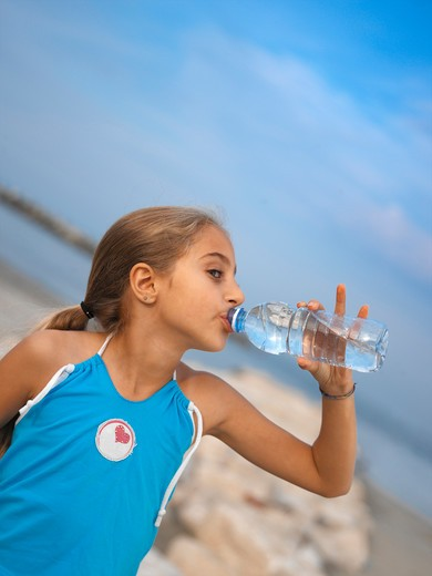 Stock Photo: 4292-66841 Girl drinking water from a bottle