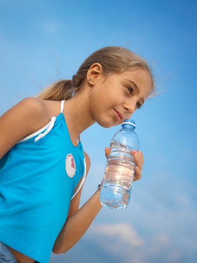 Stock Photo: 4292-66842 Girl with a botle of mineral water