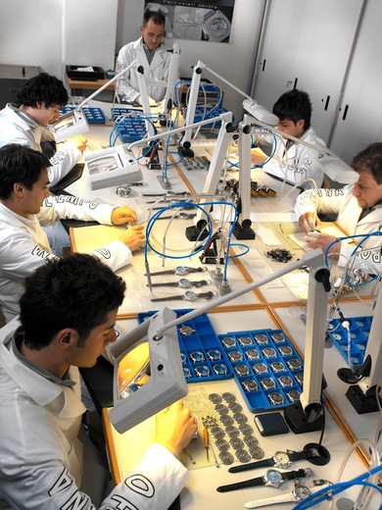 Technicians in wristwatch factory : Stock Photo