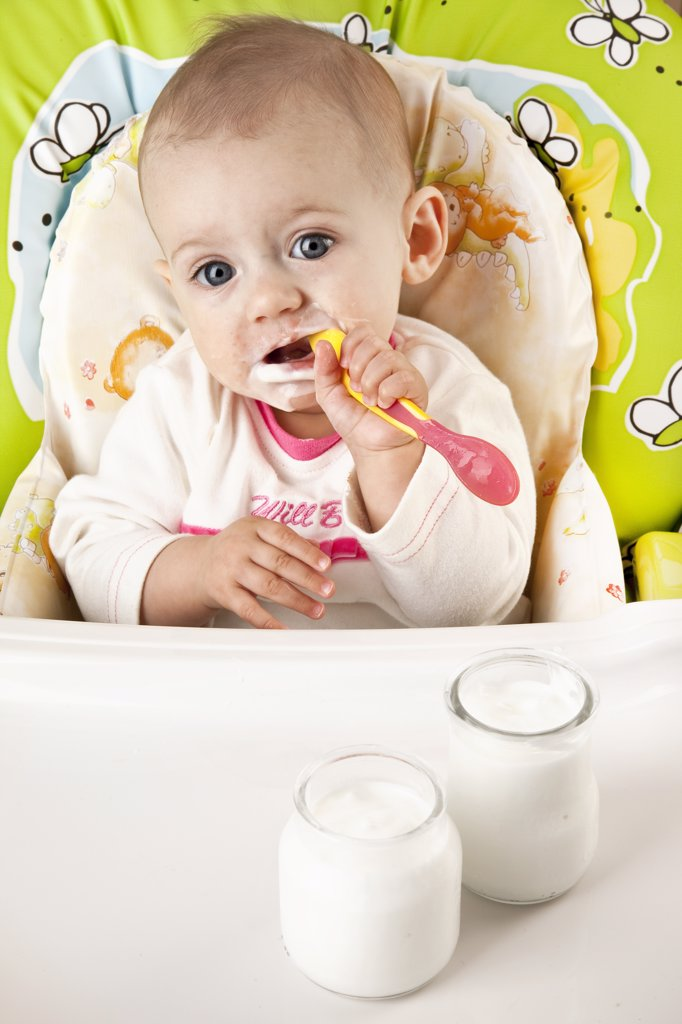 Baby eating : Stock Photo