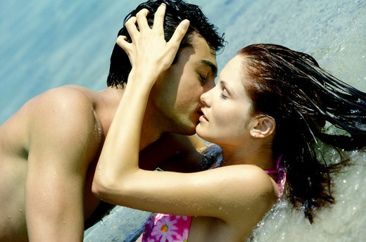 Couple kissing on sea side : Stock Photo