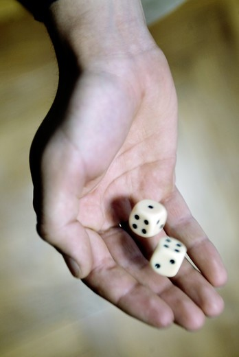 Hand with dice : Stock Photo