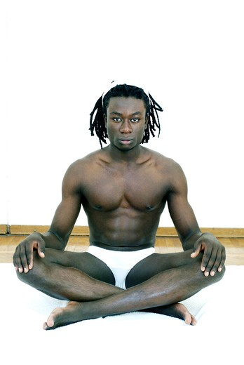 Stock Photo: 4292-73850 Afro-american man doing yoga