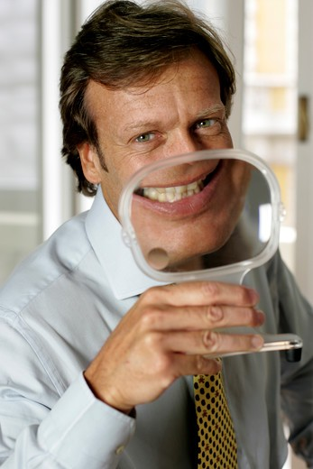 Stock Photo: 4292-74639 Man with magnifying glass on his mouth