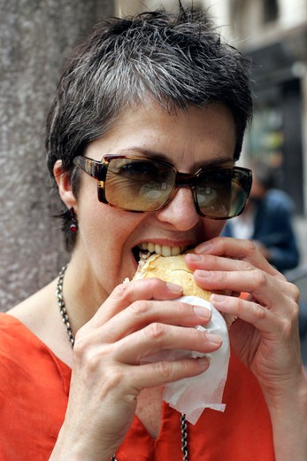 Stock Photo: 4292-74673 Woman eating sandwich