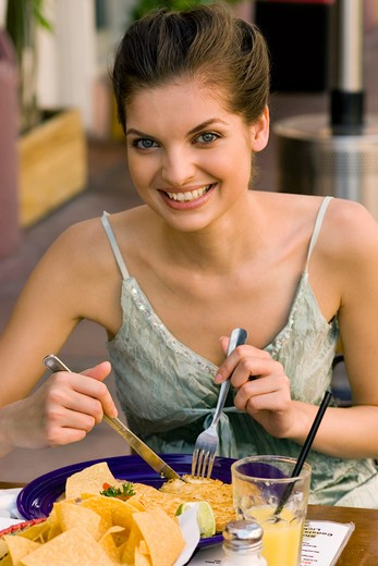 Stock Photo: 4292-75121 Woman having lunch