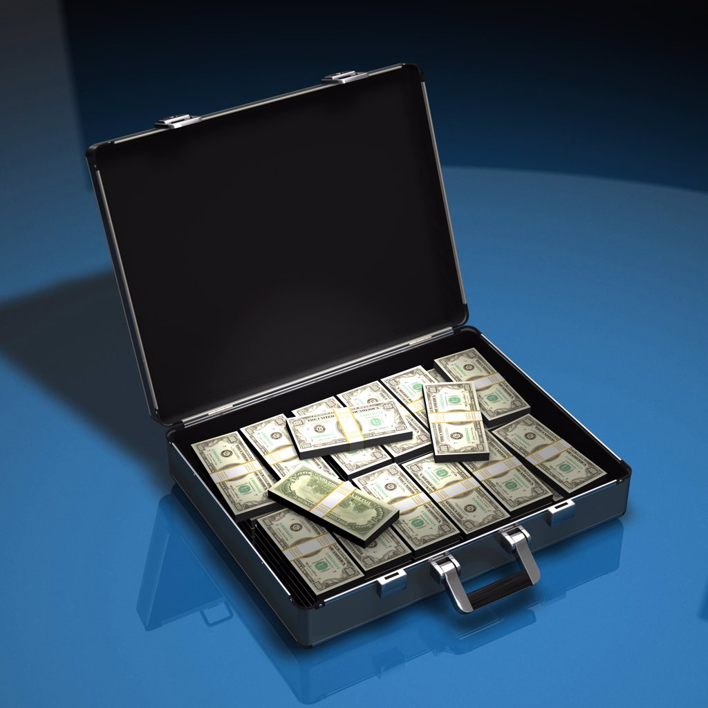 Stock Photo: 4292-76714 Briefcase filled with stacks of US dollars
