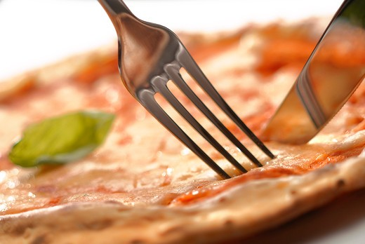 Stock Photo: 4292-76929 Cutting pizza