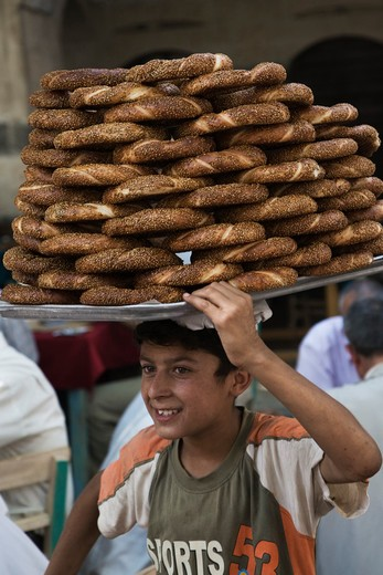 Stock Photo: 4292-79355 Turkey, Urfa, Bazaar, Young Bread Seller