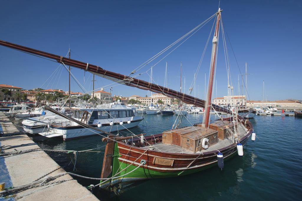 Stock Photo: 4292-79549 Italy, Sardinia, Archipelago La Maddalena National Park, La Maddalena island, Vintage boats at La Maddalena harbou