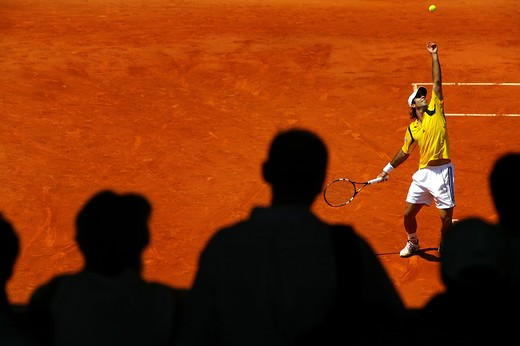 Tennis player in action play during Rolland Garros Tournament : Stock Photo