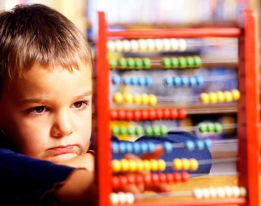 Child with abacus : Stock Photo