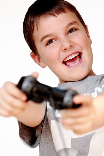 Boy playing video game : Stock Photo