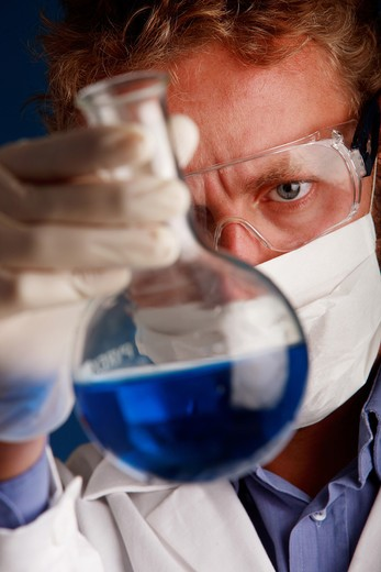 Stock Photo: 4292-86086 Male scientist examining beaker