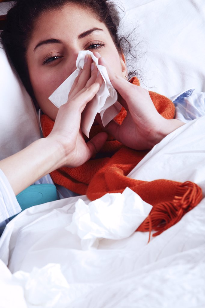 Woman blowing nose : Stock Photo
