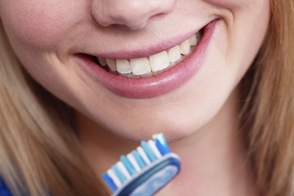 Stock Photo: 4292-86324 Woman with toothbrush