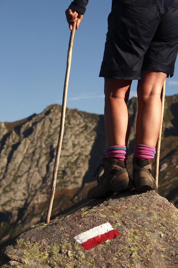 Mountain trekking, legs detail : Stock Photo