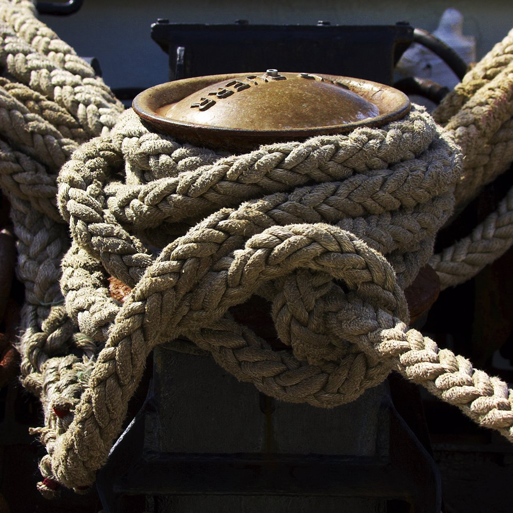Stock Photo: 4292-92383 Ropes rolled up on a sailboat's deck