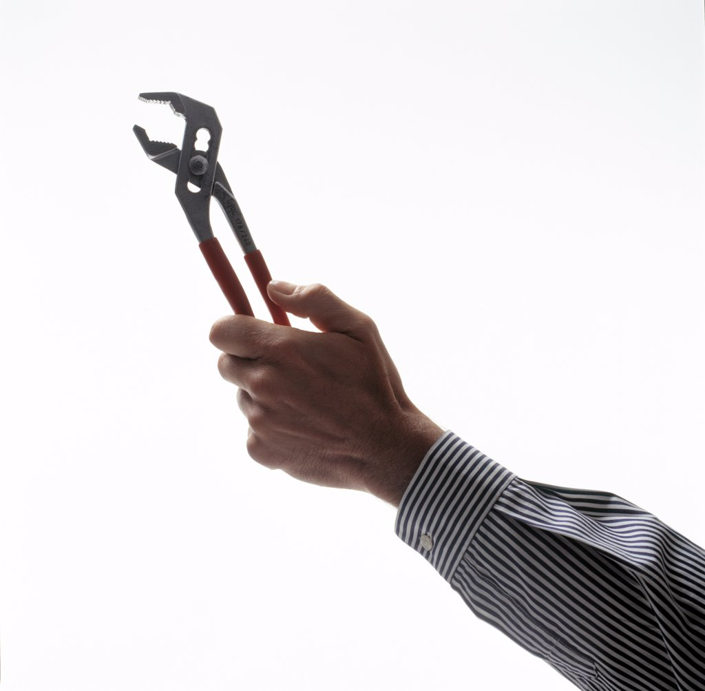 Stock Photo: 4292-96240 Man holding plier