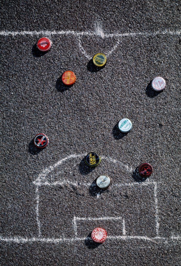 Stock Photo: 4292-96286 Caps in a football field drawn on asphalt