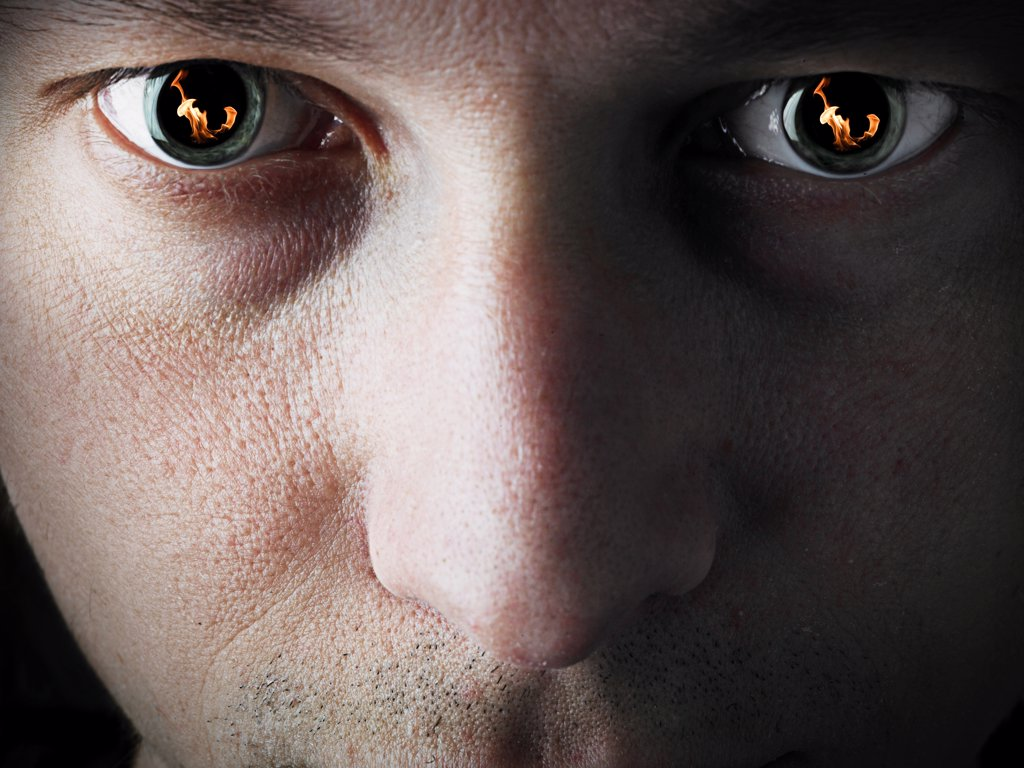 Stock Photo: 4292-96709 Close-up of man's eyes with flames reflected