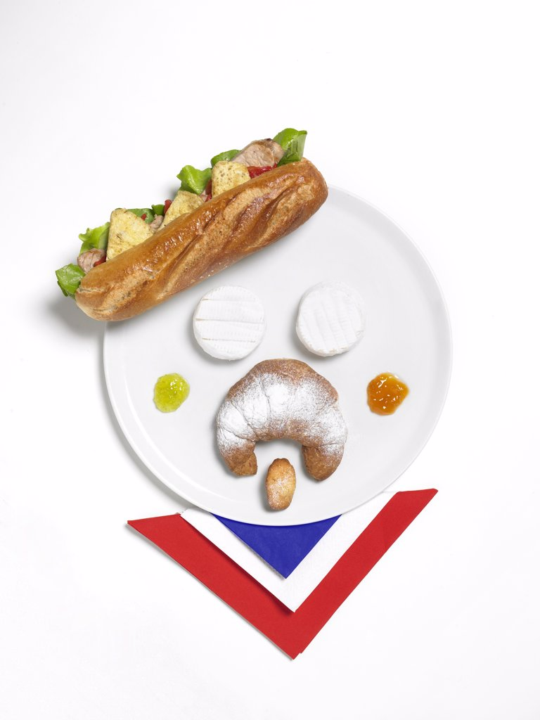 Stock Photo: 4292-96827 Typical french food on dish shaped as human face