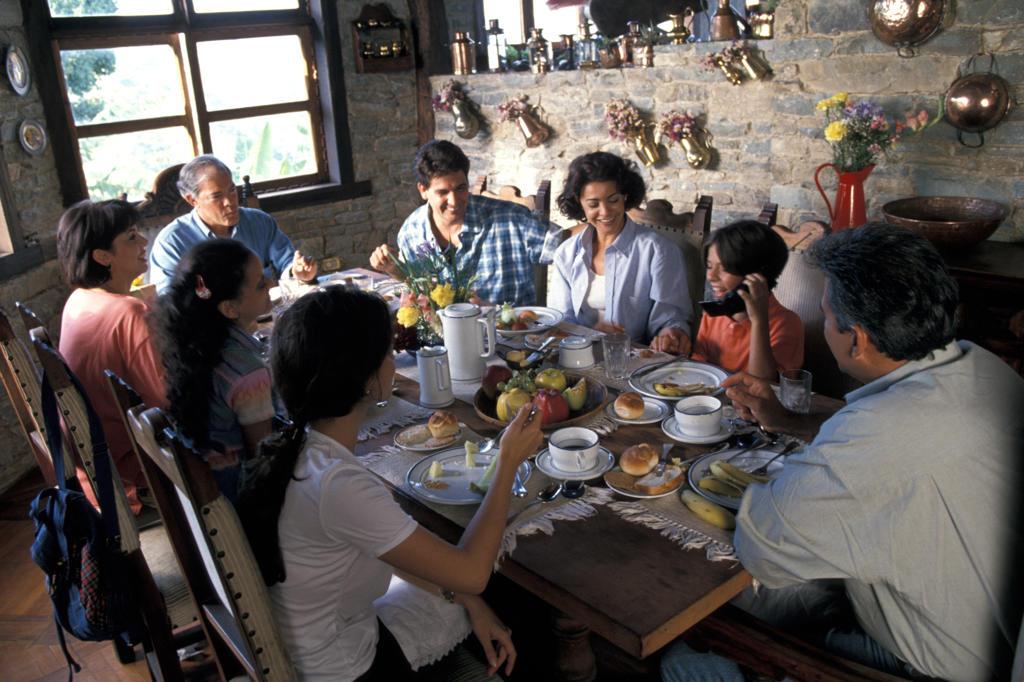 Family having breakfast : Stock Photo