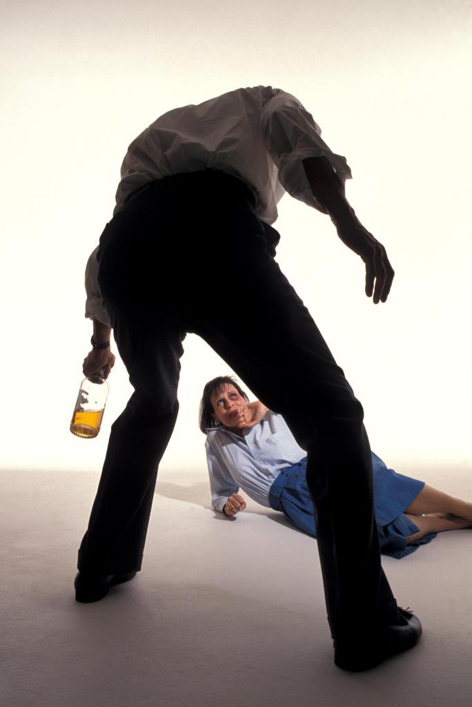 Alcoholism: man abusing woman : Stock Photo