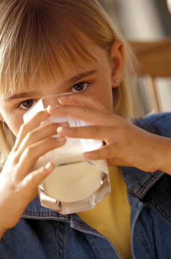 Young girl drinking milk : Stock Photo