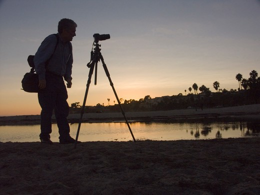 Stock Photo: 4292-99717 USA, California, Santa Barbara, photographer on beach at sunset